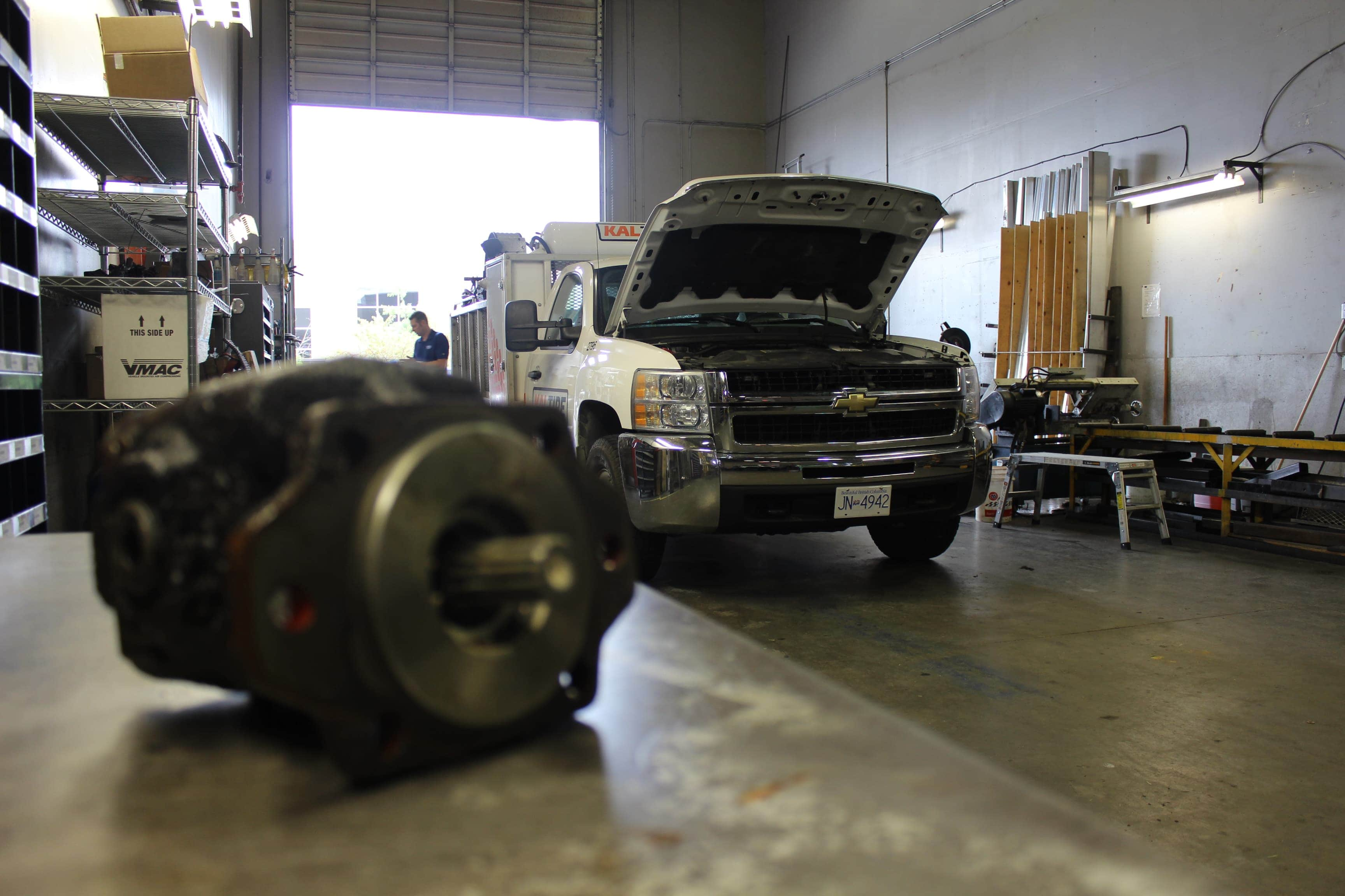 Work truck being repaired on in the shop